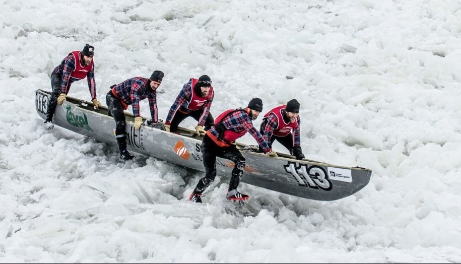 Quebec, Canada - February 8, 2015: This is the Quebec Ice Canoe Race Competition that happens on the St.Lawrence River every winter.